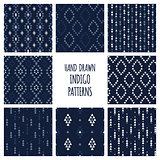 Set of hand drawn indigo blue patterns. Seamless vector tribal indian backgrounds with triangles, arrows, rhombuses and diamonds.