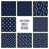 Set of hand drawn indigo blue patterns. Seamless vector native american backgrounds with triangles and arrows.