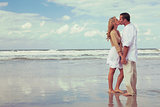 Romantic Man and Woman Couple Kissing On A Beach