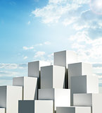 A group of tall cubes against a blue sky