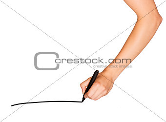 A female hand holds black marker and draws line
