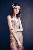 Fashion photo of beautiful girl wearing sparkling evening dress.