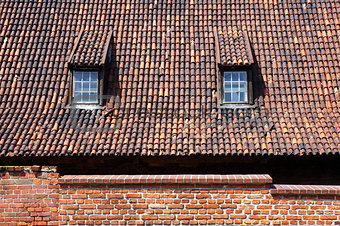 Tiled roof with dormers in Gdansk, Poland.