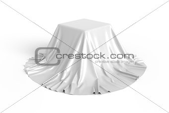 Box covered with white fabric.