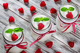 yogurt with raspberries and mint, selective focus