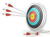 Archery target with red arrows in the center