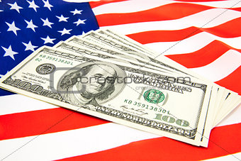American dollars and flag.