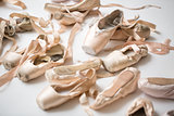 Many pairs of ballet shoes