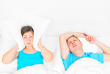woman can not sleep from snoring husband, the pillow covering he