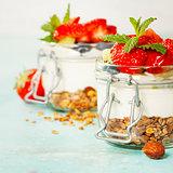 Healthy breakfast. Homemade yogurt parfait with granola, berries