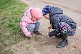 Children draw on the ground