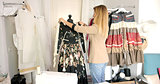 Female using mannequin for sewing