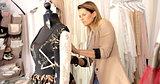 Female dressmaker using mannequin in parlour