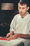 Preparing sashimi set in restaurant kitchen