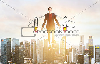 Business man hover over city skyline