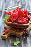 Wooden bowl with dried hibiscus flowers.