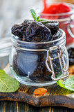 Dried prunes in a glass jar.