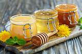Different varieties of honey in glass jars.