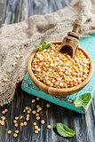 Wooden bowl with yellow peas.