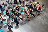 Overhead View Of Audience Applauding Speaker At Conference