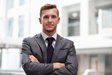 Head And Shoulders Portrait Of Young Businessman In Office