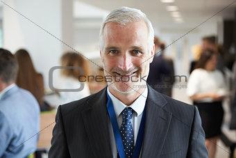 Portrait Of Male Delegate During Break At Conference