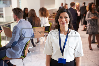 Portrait Of Female Delegate During Break At Conference