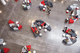 Students groups sitting in a modern university atrium