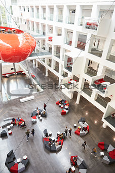Modernist interior of a university atrium, vertical