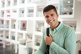 Young adult Middle Eastern male student smiling to camera