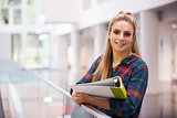 Female adult student in modern university building, portrait