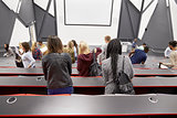 Students leaving university lecture theatre, back view