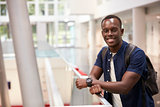 Smiling black male student in modern university, portrait