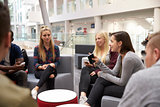 Students meeting in the foyer of modern university building