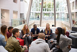 Students sitting in the foyer of modern university building