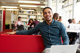 Portrait Of Male University Student Working In Library