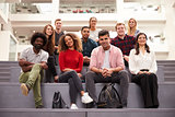 Portrait Of Student Group On Steps Of Campus Building
