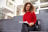 Portrait Of Female University Student In Campus Building