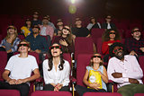 Audience In Cinema Wearing 3D Glasses Watching Comedy Film
