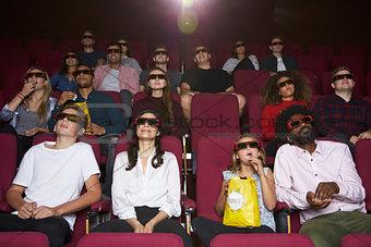 Audience In Cinema Wearing 3D Glasses Watching Film