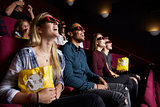 Young Couple In Cinema Wearing 3D Glasses Watching Film