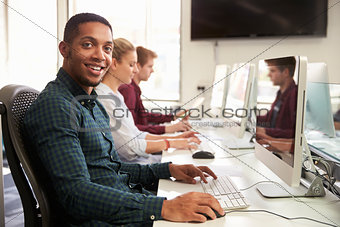 Portrait Of Male University Student Using Online Resources