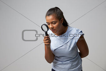 Portrait Of Female Criminologist With Magnifying Glass
