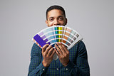 Studio Portrait Of Graphic Designer With Color Swatches