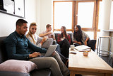 Students Relaxing In Lounge Of Shared Accommodation