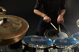 Close Up Of Drummer Playing Snare Drum On Kit In Studio