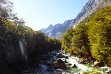River Through Mountains Near Milford Sound In New Zealand