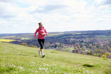 Mature Woman Jogging In Countryside