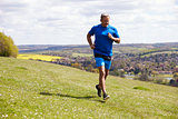 Mature Man Jogging In Countryside