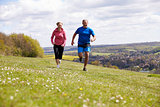 Mature Couple Jogging In Countryside